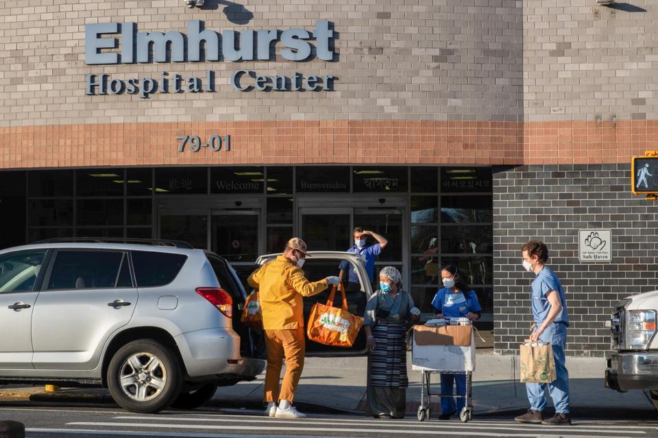 Volunteers bring in food for medical workers at Elmhurst...