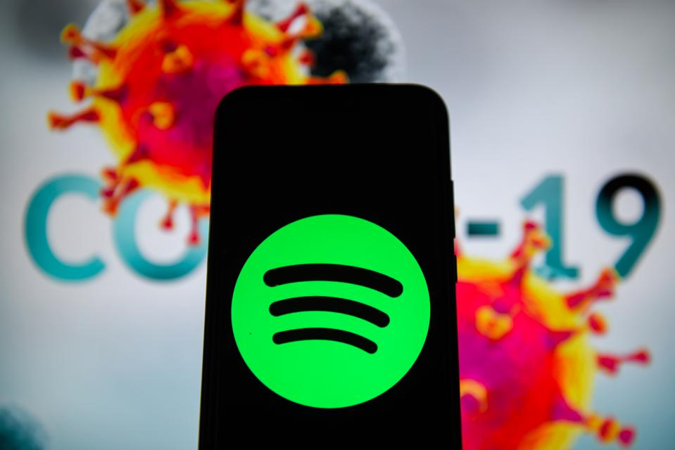 In this photo illustration a Spotify logo  is seen displayed...