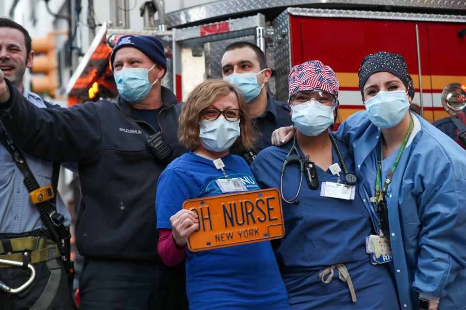 Firefighters and neighbors greet to healthcare workers in NYC