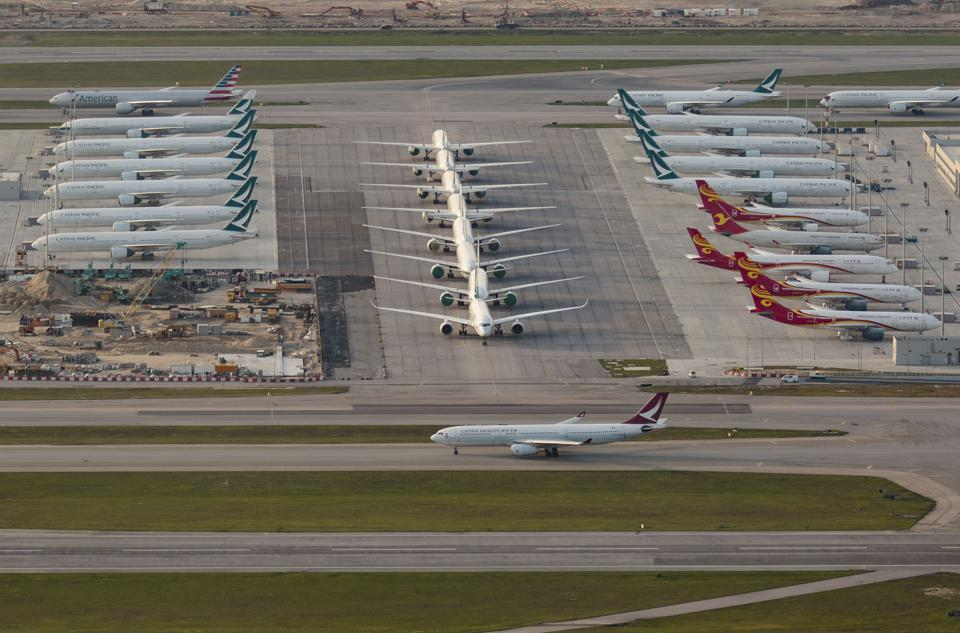 Cathay Dragon aircraft seen taxiing in front of many...