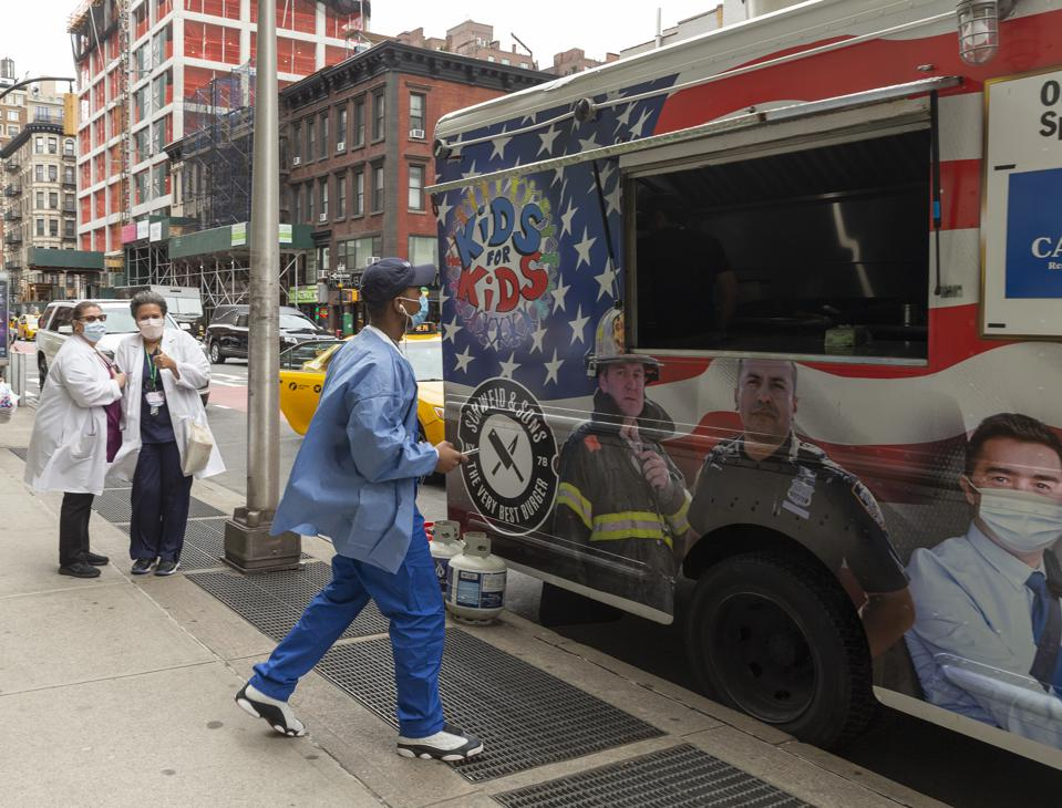 Food truck Hard Times Sundaes serves free lunch for front...