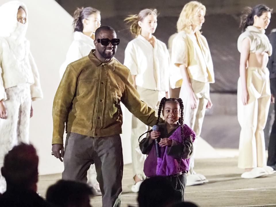 Kanye West and daughter North West on the runway of the Yeezy fashion show during Paris Fashion Week Womenswear Fall/Winter 2020/2021 on March 02, 2020 in Paris, France