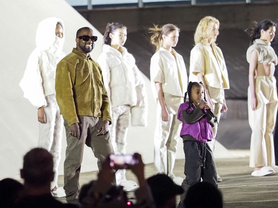 Kanye West and daughter North on the runway of the Yeezy fashion show during Paris Fashion Week 2020.