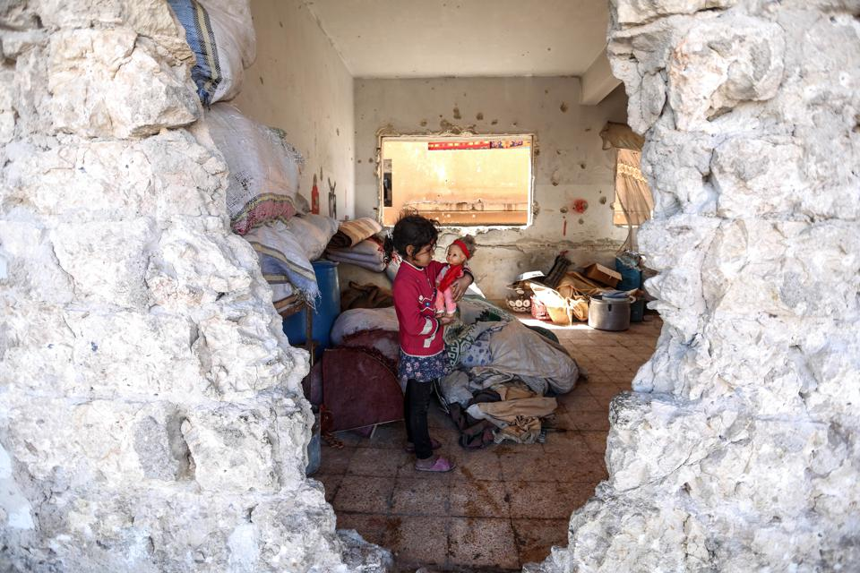 Syrian families take shelter in ruins of schools