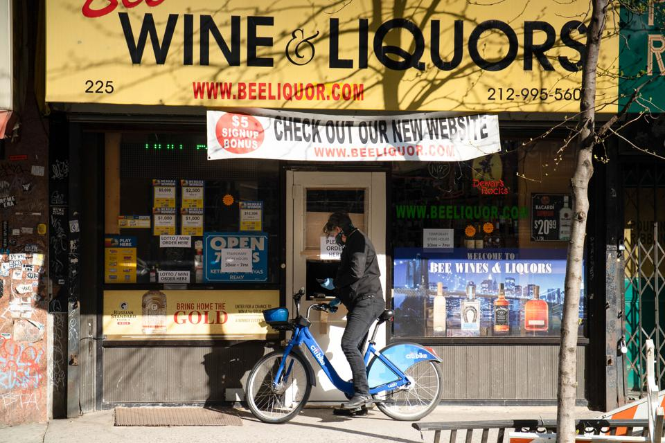 A man buys wine on an empty shop amid the coronavirus...