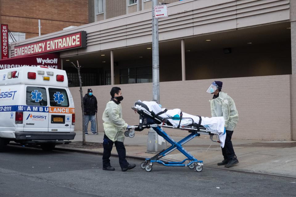An elderly woman suspected of having Covid-19 is brought into Brooklyn hospital in New York.