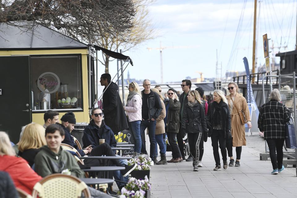 Crowds of people at Norr Mälarstrand street in Stockholm, Sweden.
