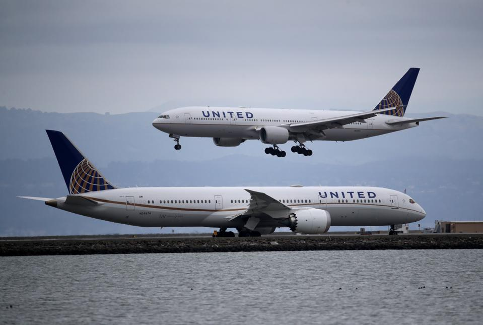 A United Airlines plane lands at San Francisco International Airport on March 06, 2020