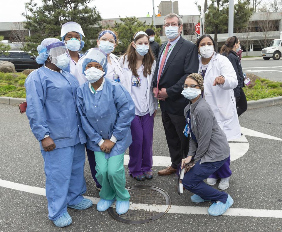 CEO of Northwell Health Michael Dowling poses with nurses,...