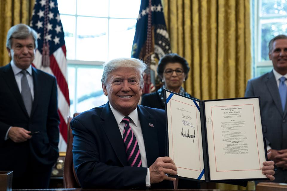 President Trump Signs Paycheck Protection Program And Health Care Enhancement Act In Oval Office