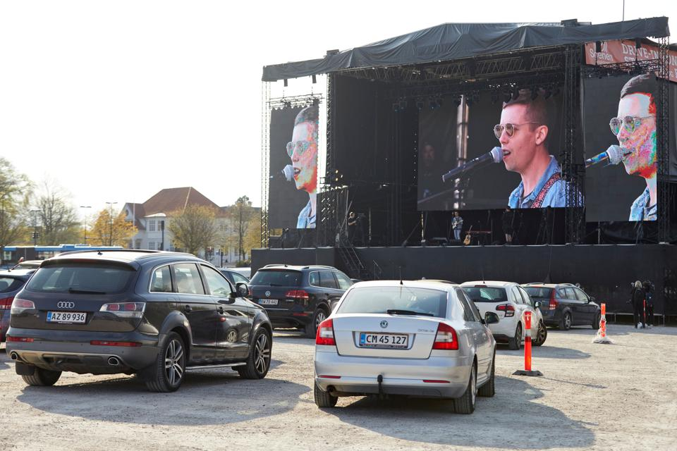 Parked cars by the stage at the drive-in concert in Aarhus, Denmark.