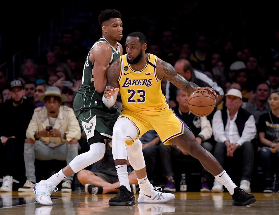 LeBron James posting up Giannis Antetokounmpo.