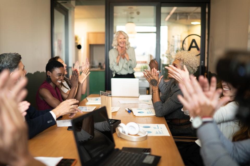 Business people applauding and celebrating a presentation speech in a business meeting