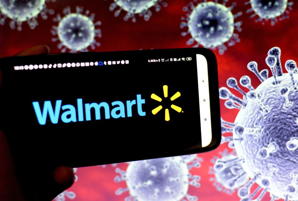 In this photo illustration a Walmart logo seen displayed on...