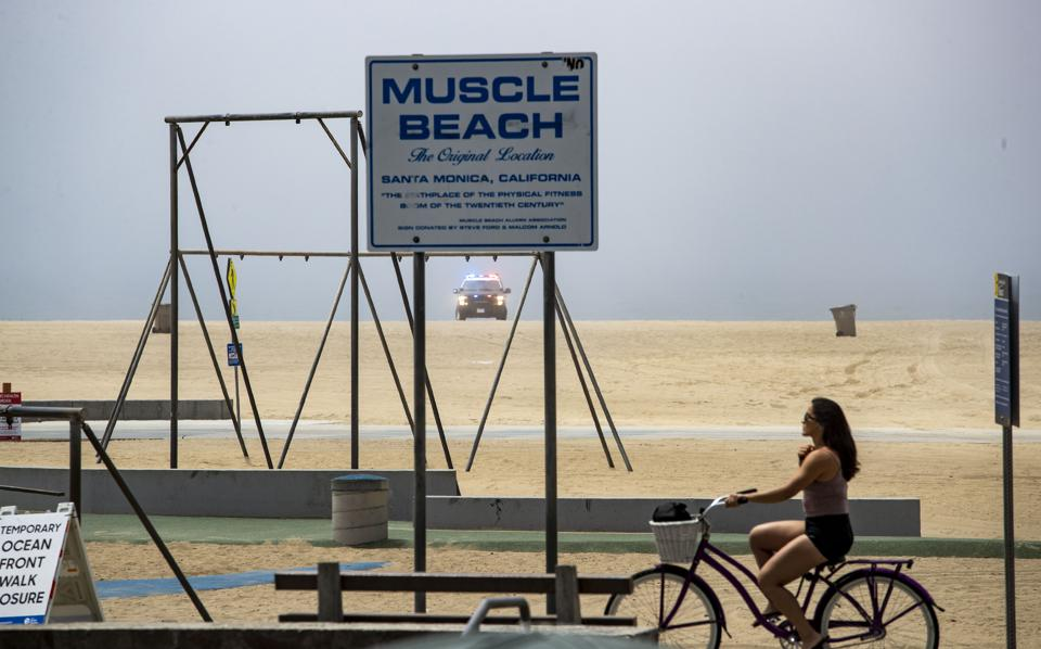 Santa Monica police keep watch over the empty beach...
