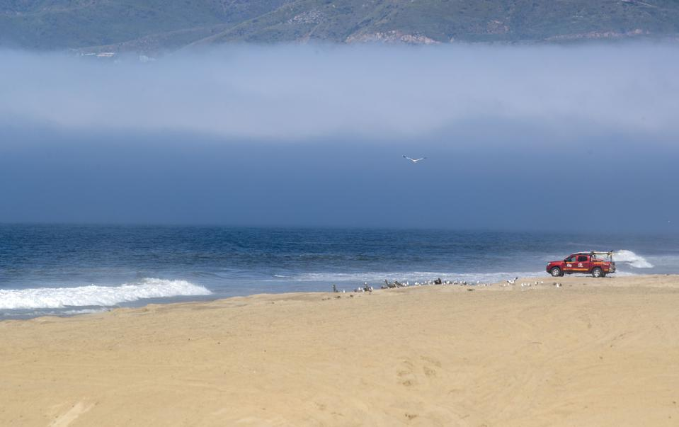 Los Angeles County lifeguards were stationed along the closed beach...