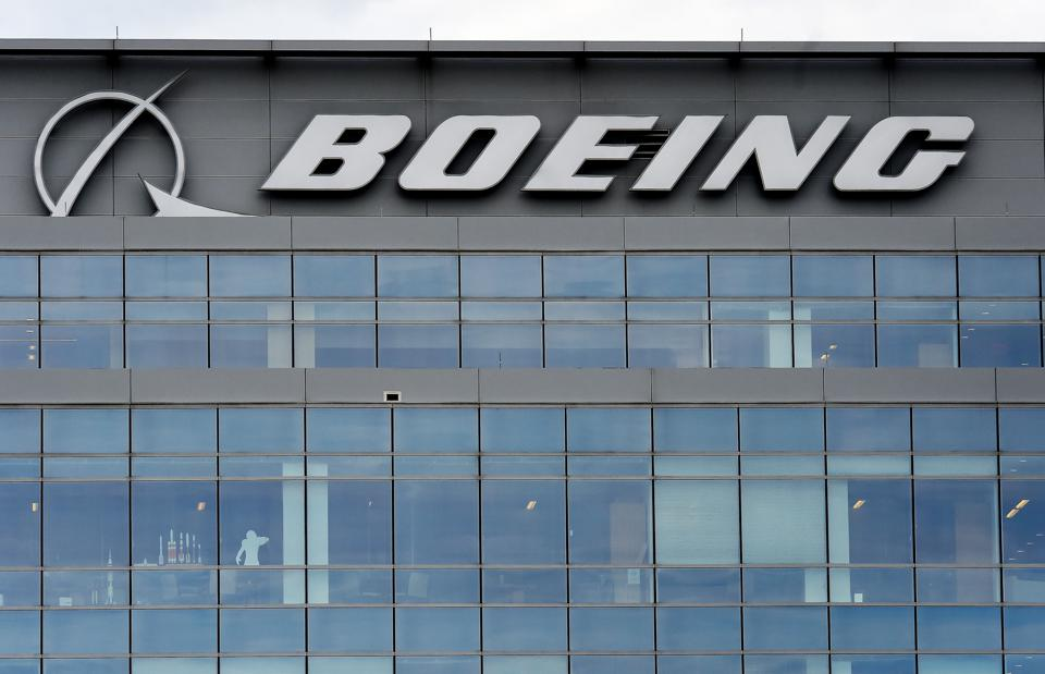 The Boeing regional headquarters is seen amid the coronavirus pandemic on April 29, 2020, in Arlington, Virginia. - Boeing announced sweeping cost-cutting measures Wednesday after reporting a first-quarter loss of $641 million following the hit to the airline business from the coronavirus pandemic. The aerospace giant plans to reduce its workforce by 10 percent through a combination of voluntary and involuntary layoffs and will slash production of its main commercial planes, including the 787 and 777, Chief Executive David Calhoun said in a message to employees that accompanied an earnings release. (Photo by Olivier DOULIERY / AFP) (Photo by OLIVIER DOULIERY/AFP via Getty Images)