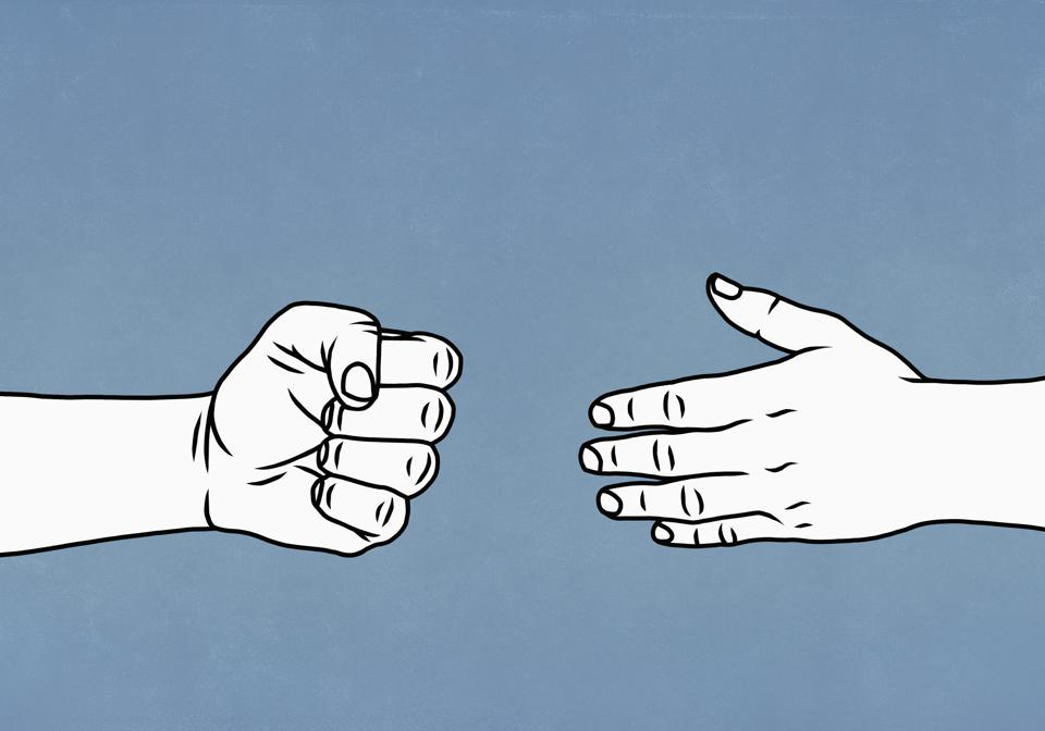 Contrasting hands open and closed in a fist
