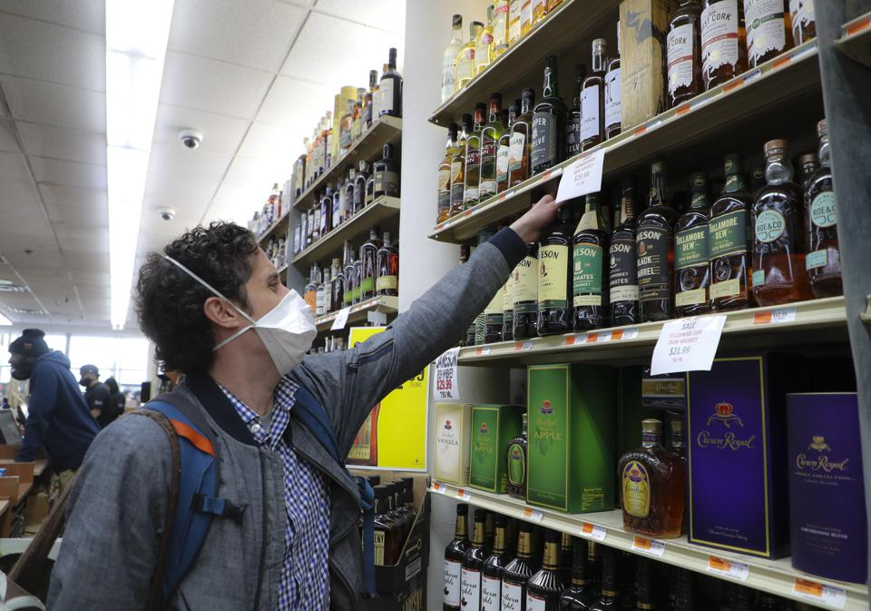 Pat ODonnell, 34, buys a 1.75 liter bottle of Jameson Irish Whiskey at Supreme Liquor in Cambridge, MA on April 28, 2020.