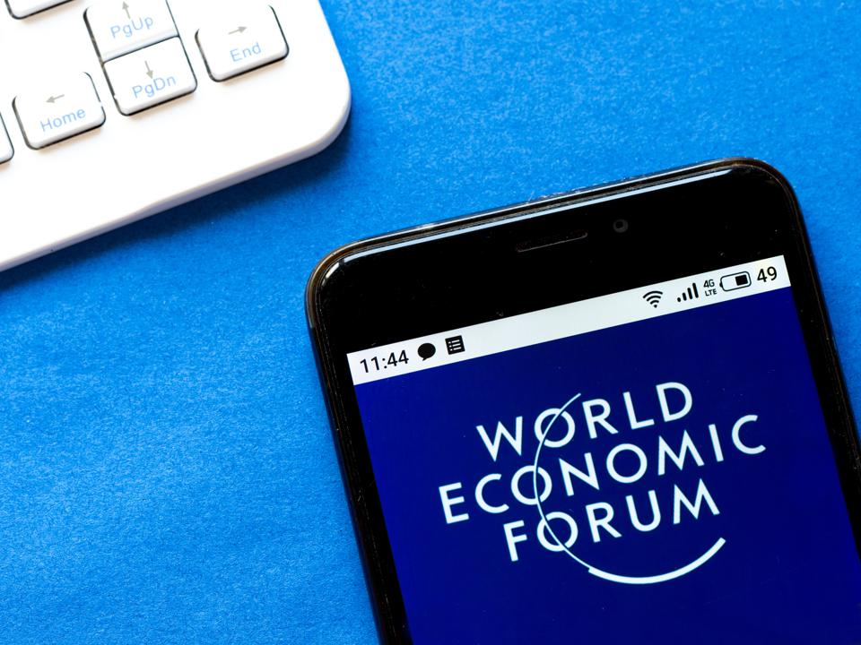 In this photo illustration a World Economic Forum logo seen...