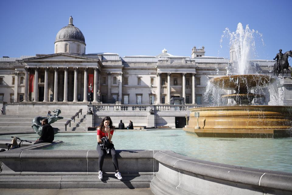 woman sits outside london National Gallery Titian Artemisia exhibition