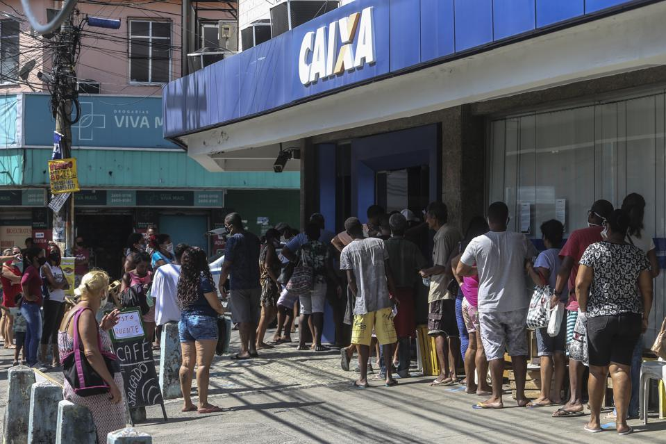 Crowds Line Up at Caixa Economica Federal to Receive Urgent Government Benefit Amidst the Coronavirus (COVID - 19) Pandemic