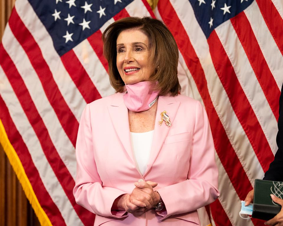 Speaker of the House, Nancy Pelosi, shepherded passage of the HEROES Act through the House of Representatives. The bill's tax provisions are estimated to cost $883 billion
