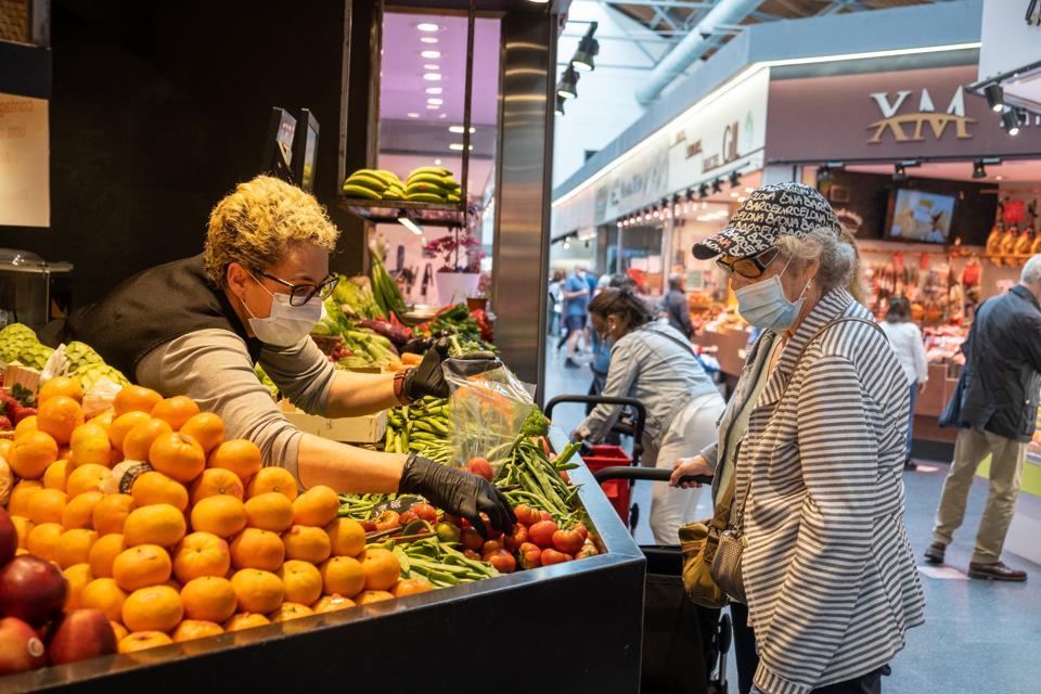 Elderly people go shopping amid coronavirus crisis in Barcelona, Spain