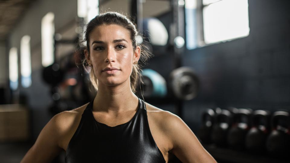 Portrait of young woman in cross training gym