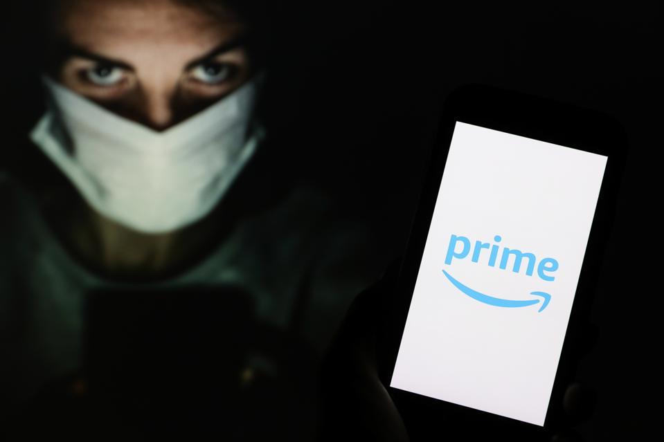In this photo illustration an Amazon Prime logo seen...