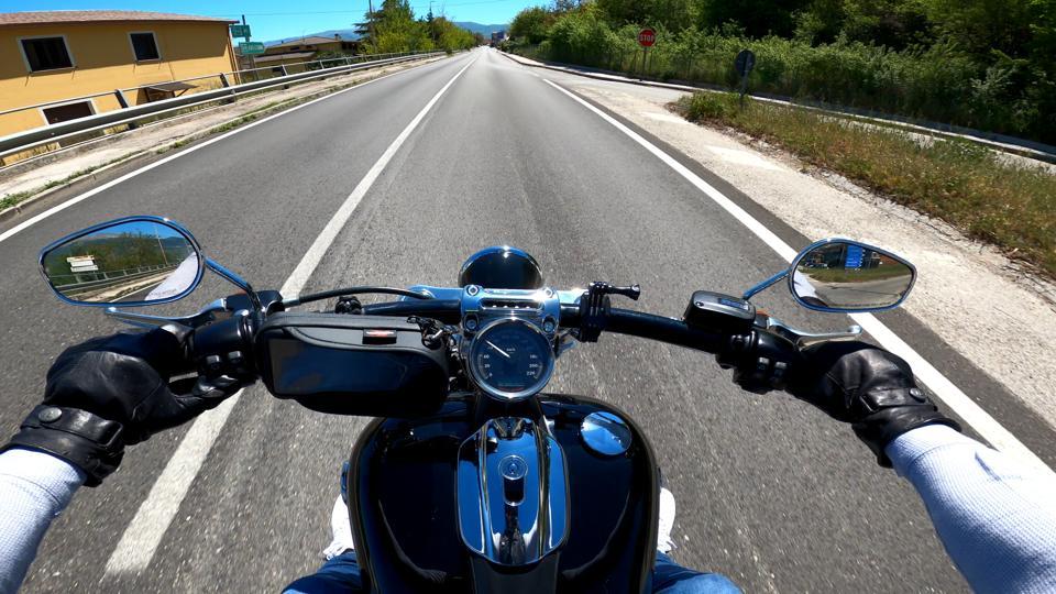 A man drives a Harley-Davidson Breakout (FXSB).
