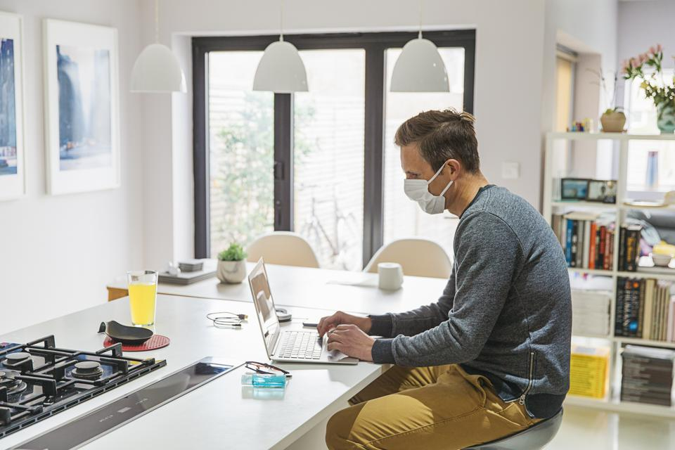Man in self isolation working from home