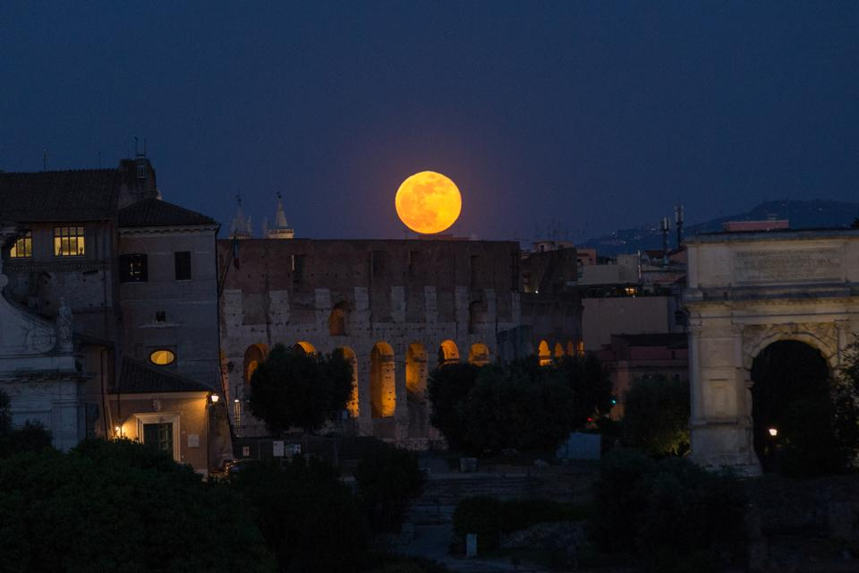 Supermoon rising over Rome's Colosseum