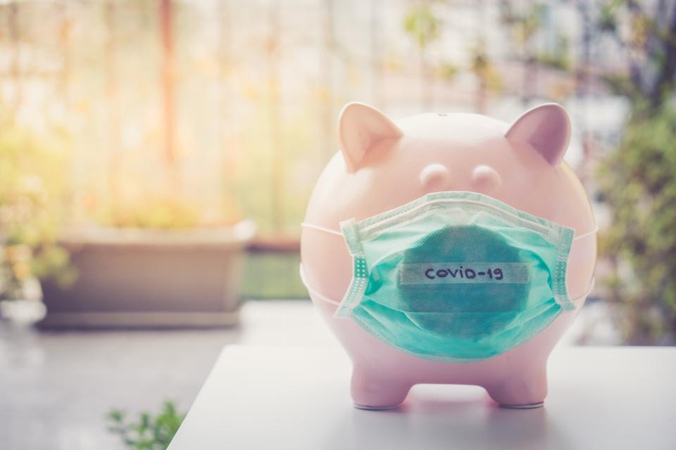 Piggy bank with Face Mask, Financial crisis and market crash due to coronavirus