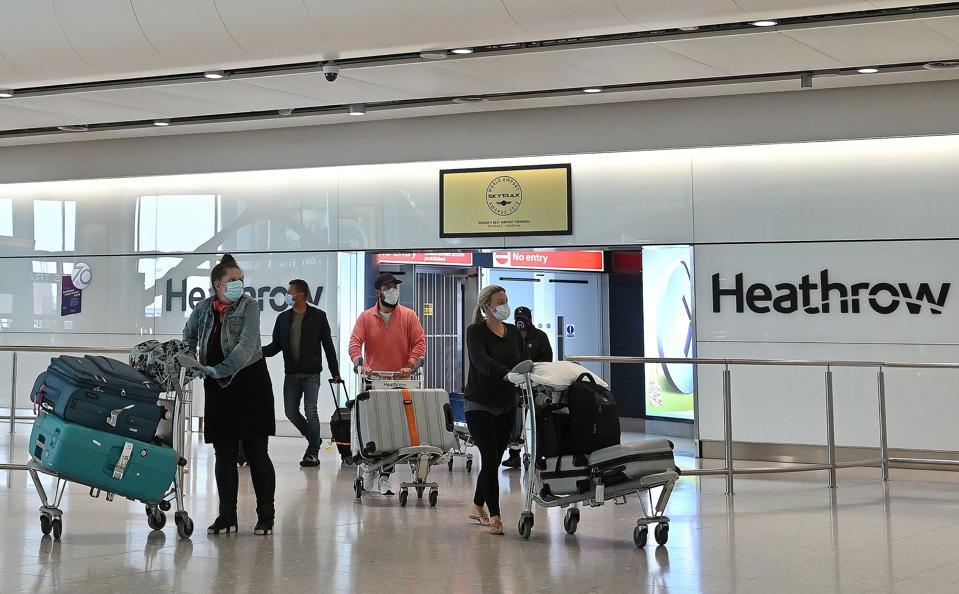 BRITAIN-coronavirus-quarantine-on-arrival-all-travelers