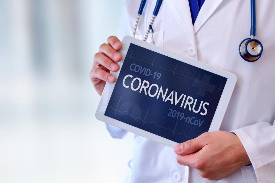 Doctor showing coronavirus and COVID-19 title on a tablet