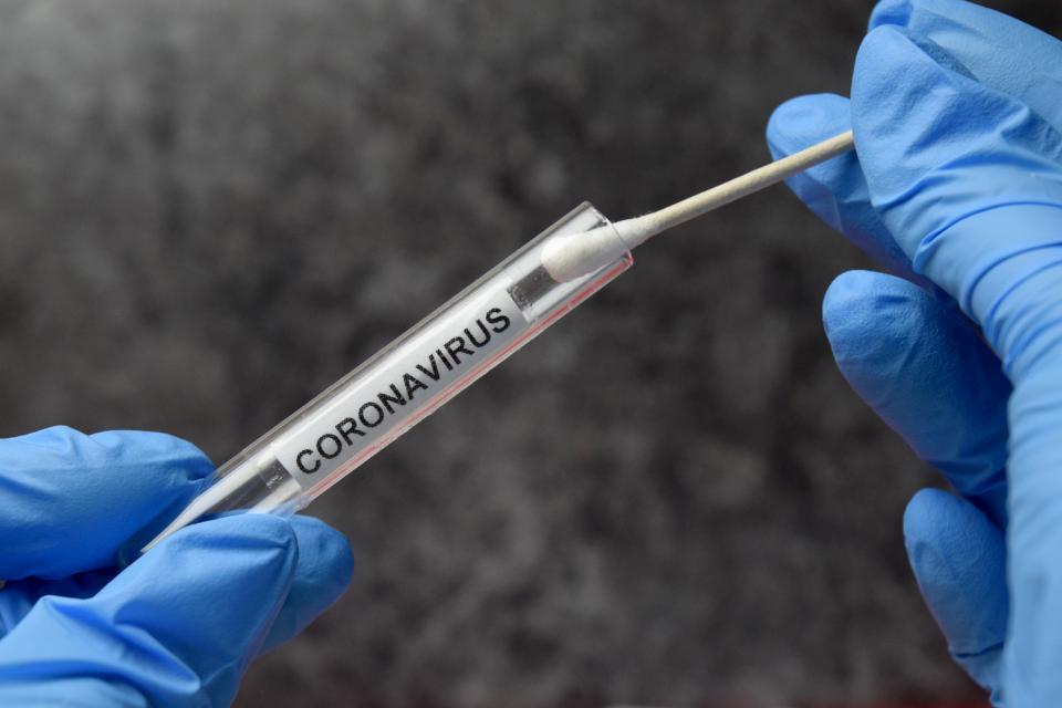 Swab and a test tube labeled ″Coronavirus.″