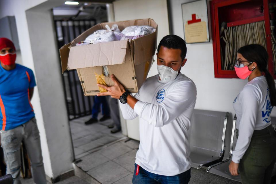 VENEZUELA-HEALTH-VIRUS-ELDERLY-VOLUNTEERING