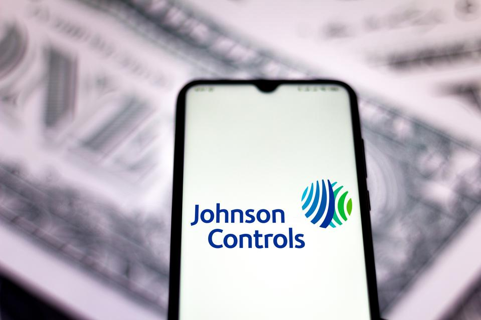 In this photo illustration the Johnson Controls logo seen...