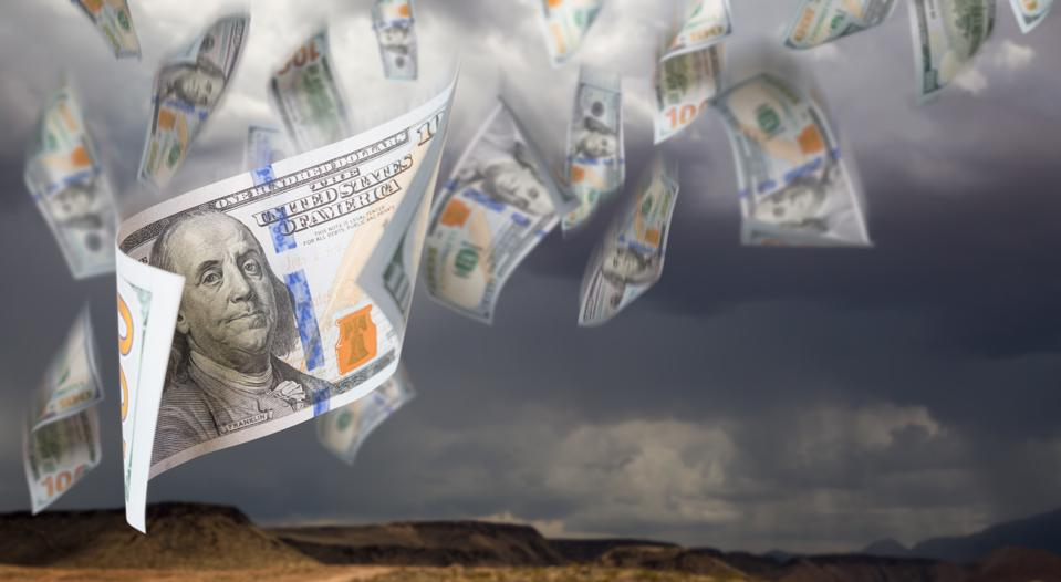 Several 100 Dollar Bills Falling From Stormy Cloudy Sky.