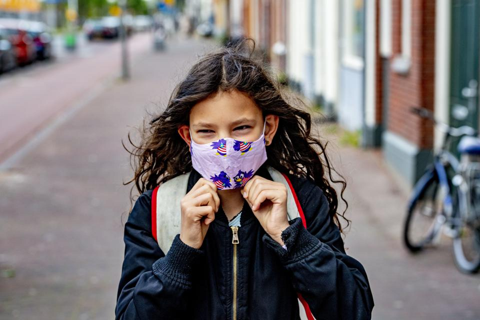 A child going to school while wearing a face mask