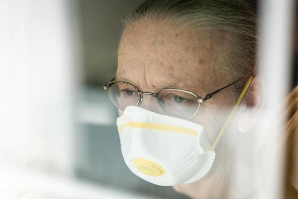Senior woman in a quarantine of Coronavirus- worrying about social security