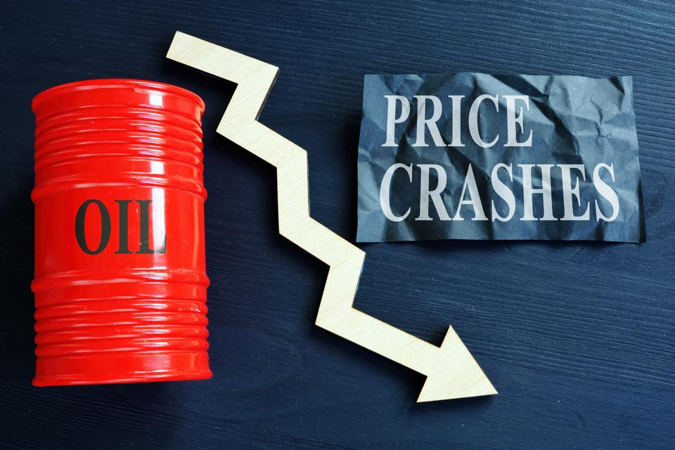 Price crashes sign and crude oil barrel with falling arrow.