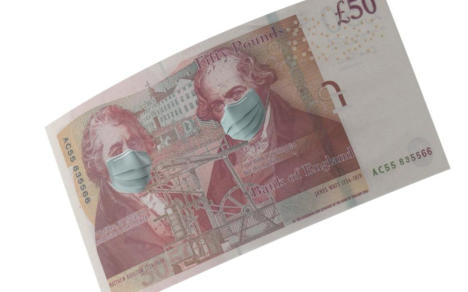 British Fifty Pound Note with Mask Protection For Coronavirus on Economy Against White Background
