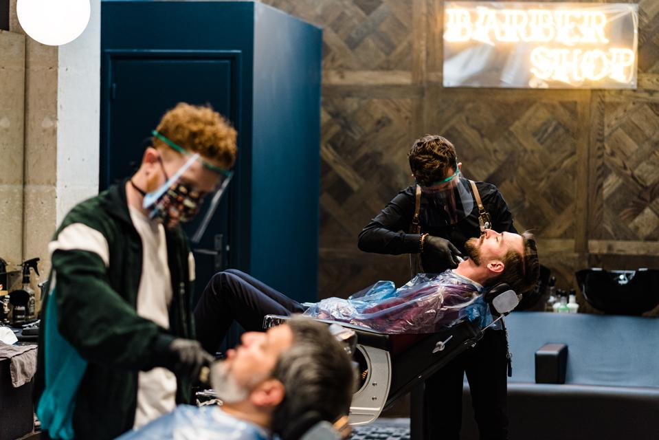 Barbers go back to work in Paris on May 11, 2020–not everyone can work from home.