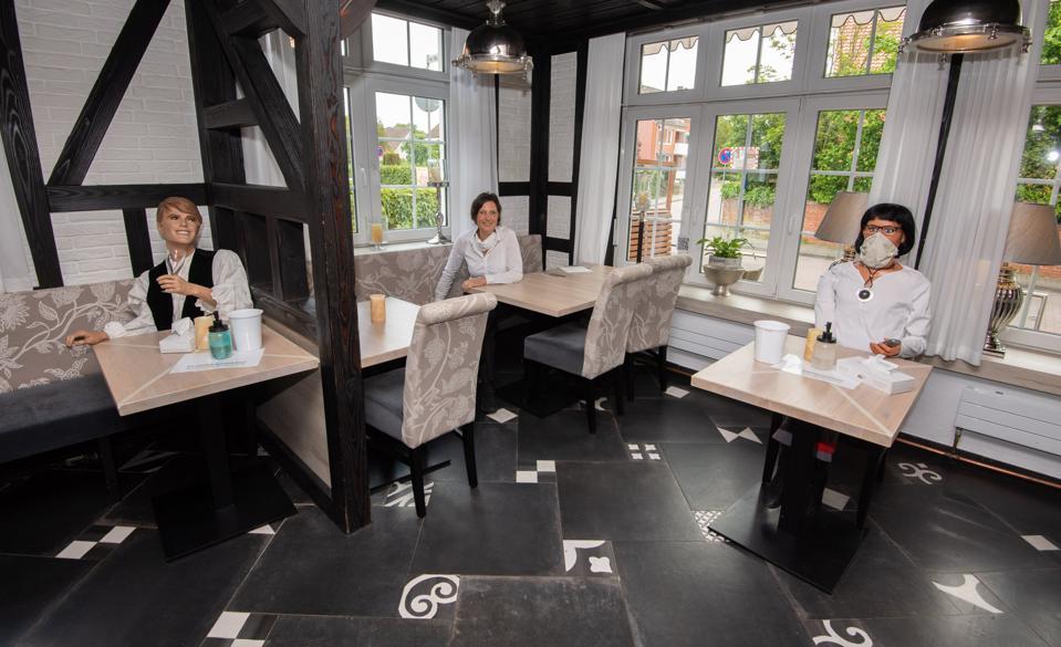 Coronavirus - dolls on empty seats in the restaurant