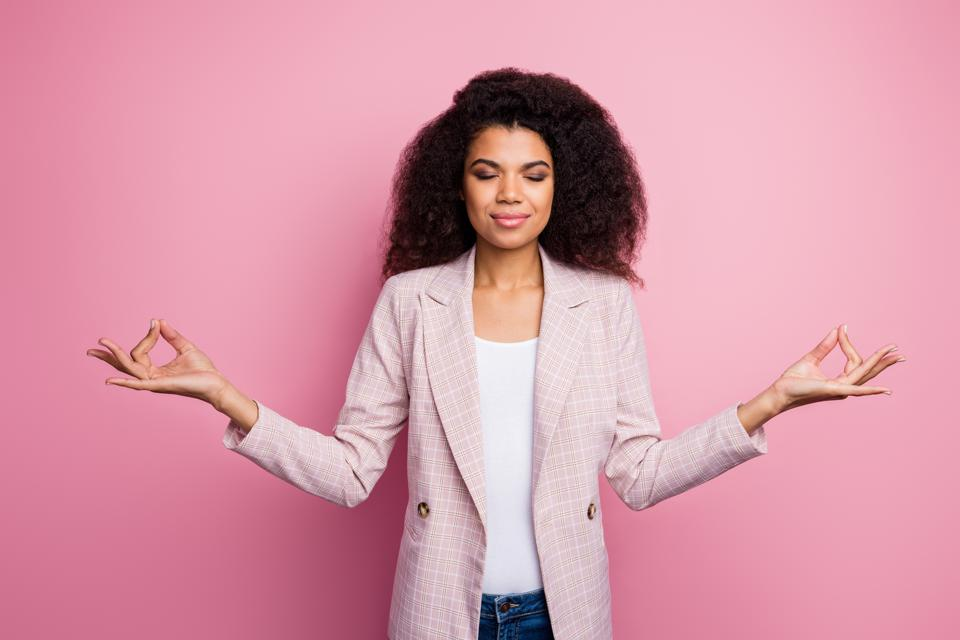 Photo of beautiful dark skin business lady hold fingers om position think mantra eyes closed meditating break work pause wear plaid blazer jeans isolated pink pastel color background