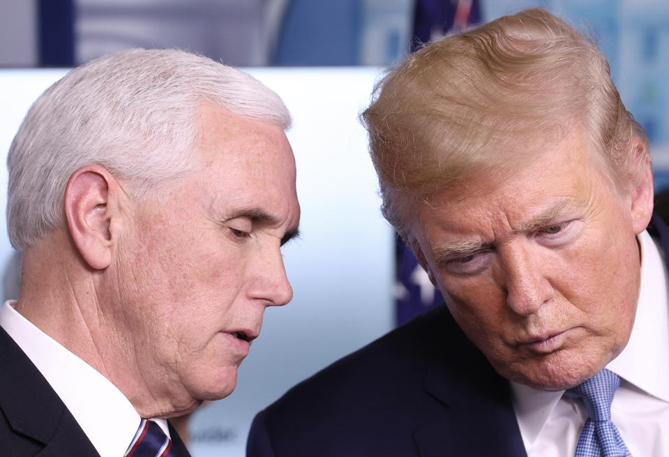 Coronavirus Task Force briefs press at White House. President Trump confers with Vice President Pence during the conference.