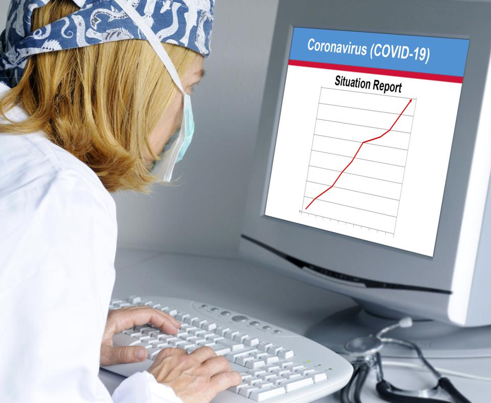 Doctor looking at coronavirus situation report
