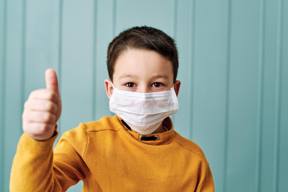 6-7 years old cute child wearing surgical mask.